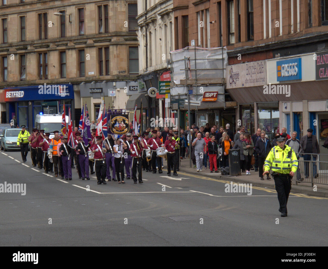 sectarian orange walk order protestant march Glasgow Scotland heavy police presence - Stock Image