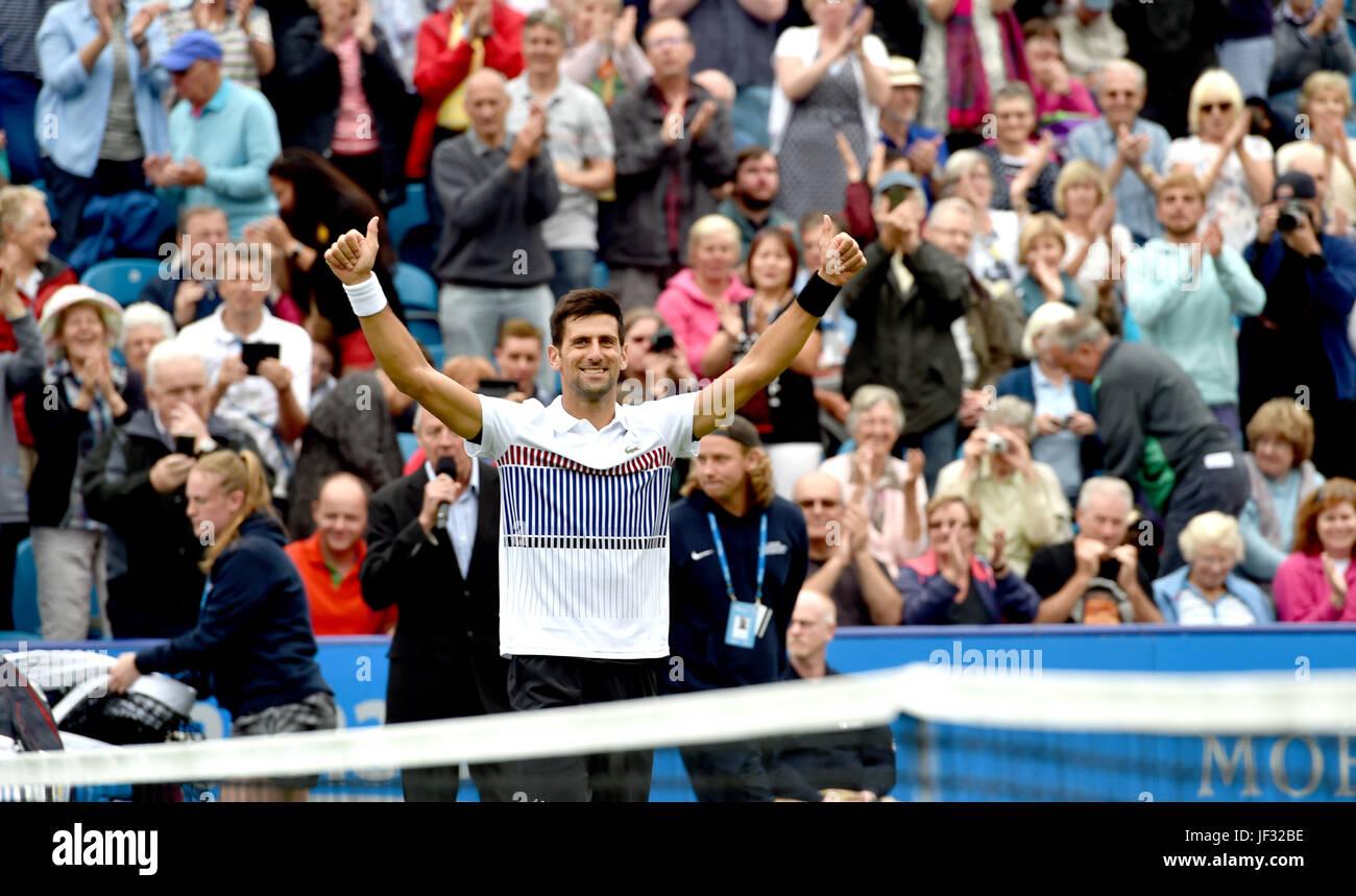 Novak Djokovic of Serbia celebrates beating Vasek Pospisil  at the Aegon International Eastbourne tennis tournament - Stock Image