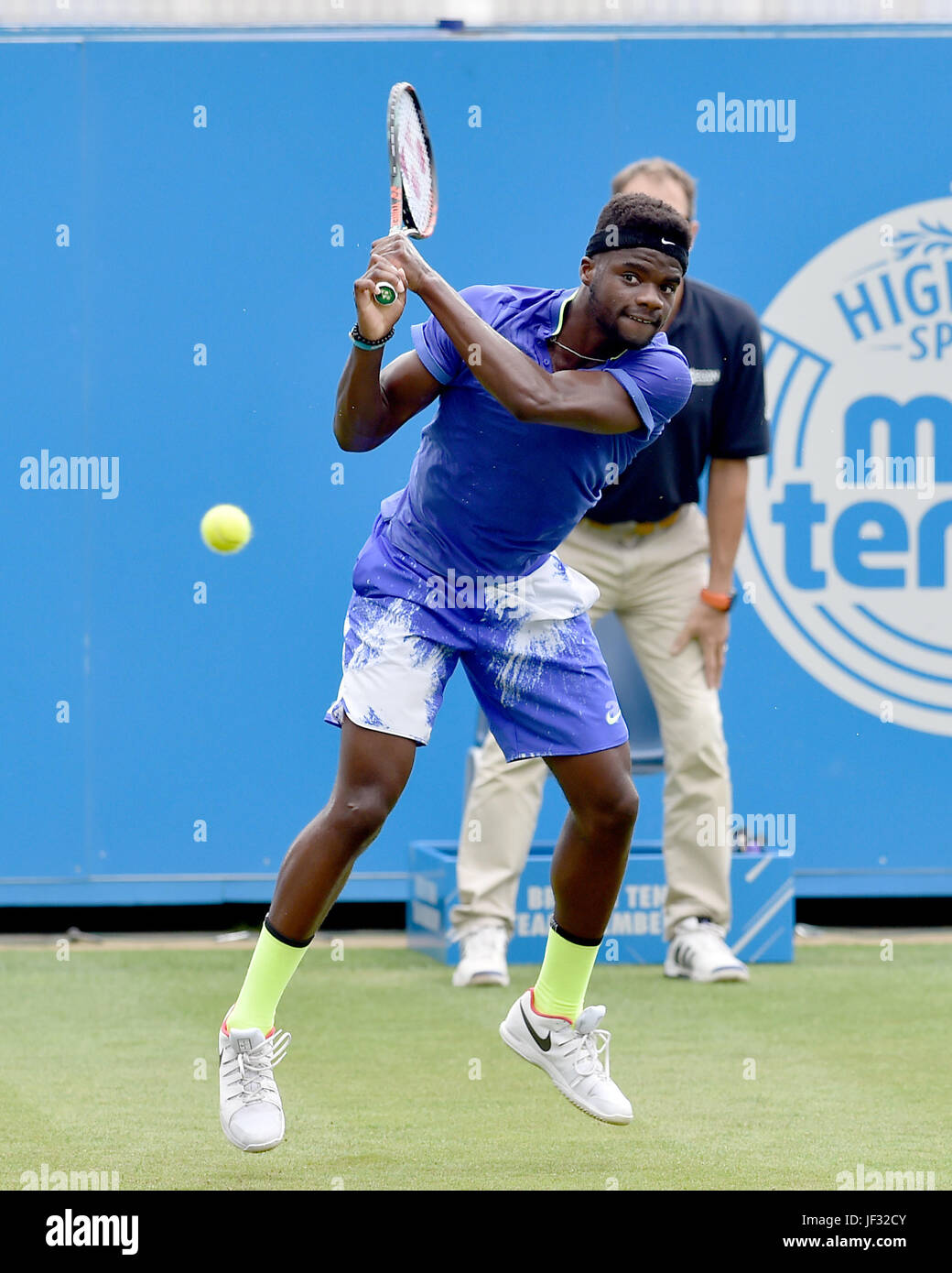 Frances Tiafoe of USA in action at the Aegon International Eastbourne tennis tournament at Devonshire Park , Eastbourne - Stock Image