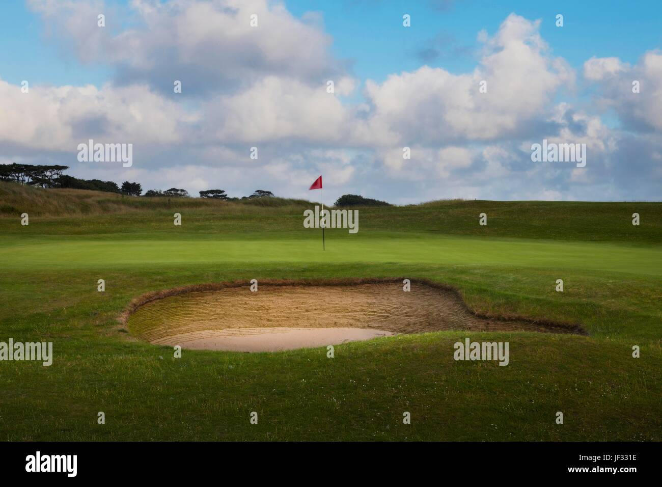 Golf bunker and green - Stock Image