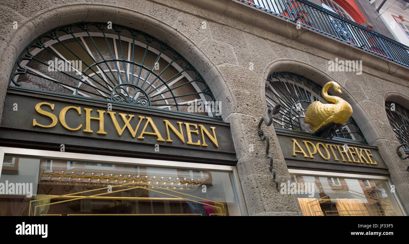 Name board and swan icon of Schawanen Apotheke, Krämerstrasse, Wetzlar, Germany - Stock Image