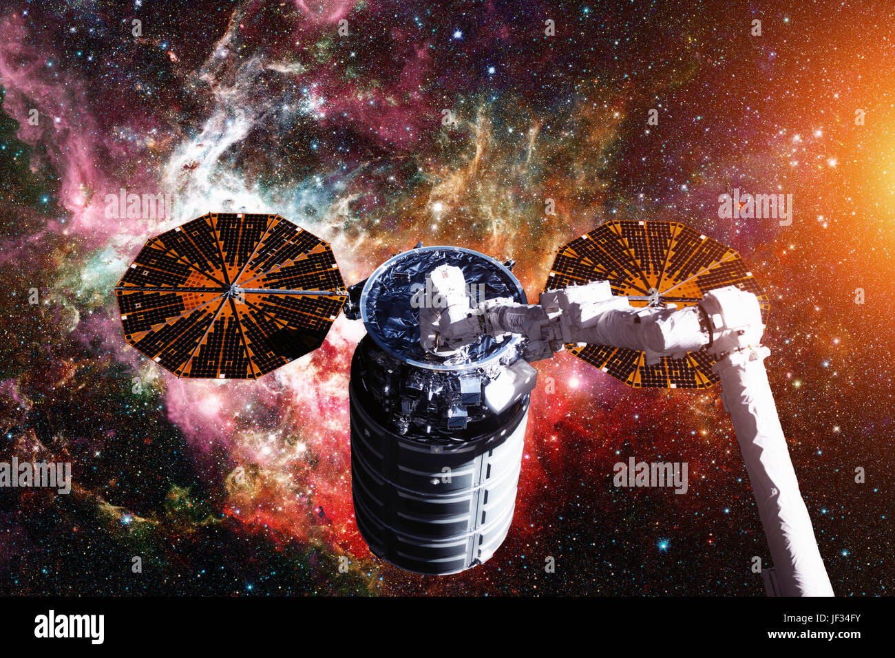 The Cygnus spacecraft in open space. Elements of this image furnished by NASA. - Stock Image