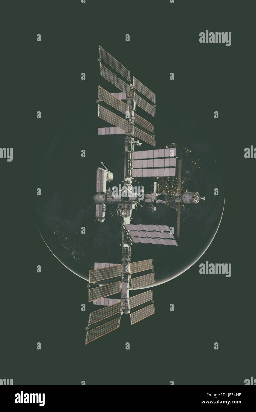 International Space Station over the planet Earth. Elements of this image furnished by NASA. Stock Photo