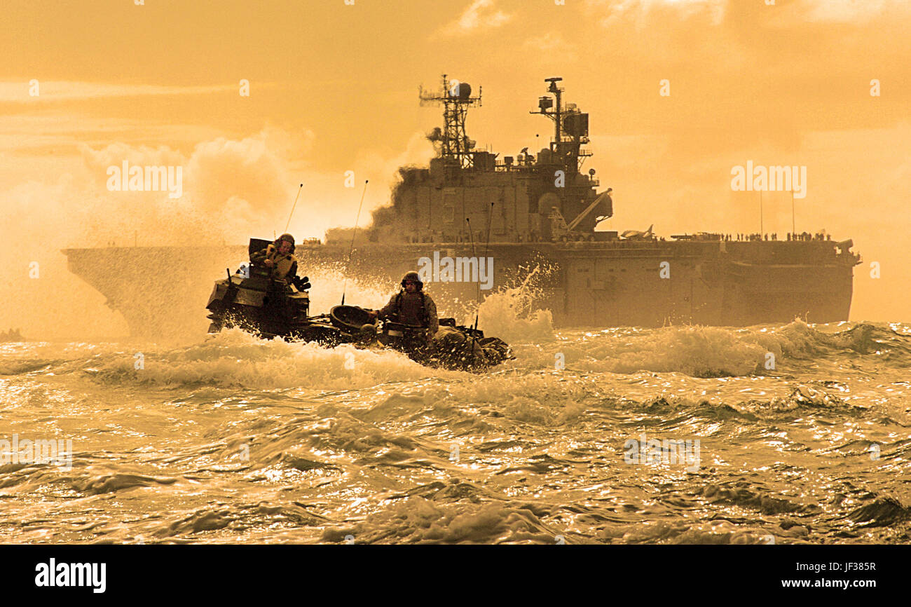 050627-N-9866B-012  A U.S. Marine Corps amphibious assault vehicle travels through the Pacific Ocean after departing Stock Photo