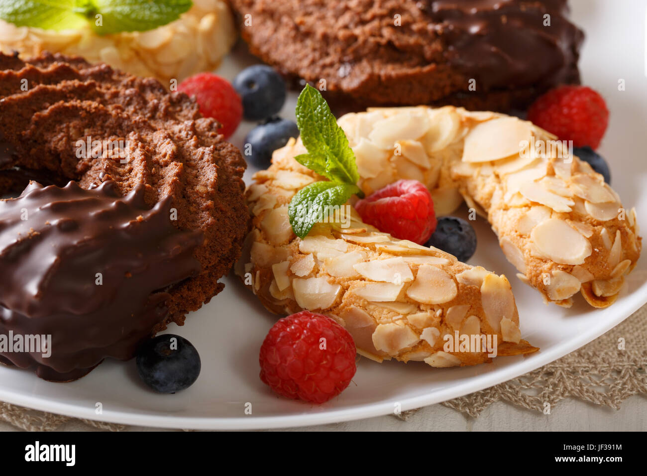 Beautiful Horseshoe Cakes With Chocolate And Almonds Close Up On A
