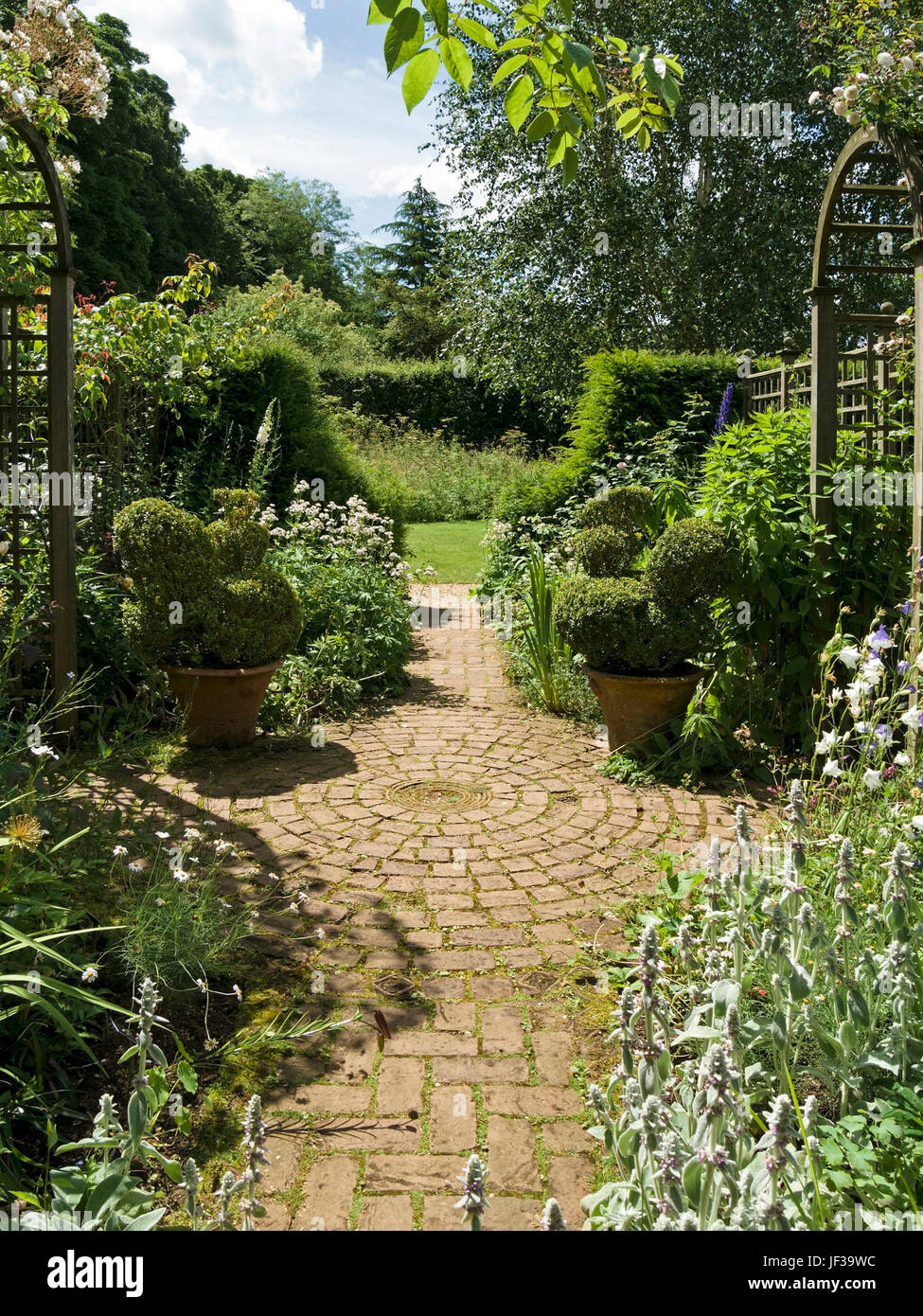 Ornate, decorative block paver path with circular pattern in garden, Barnsdale Gardens, Oakham, Rutland, UK - Stock Image