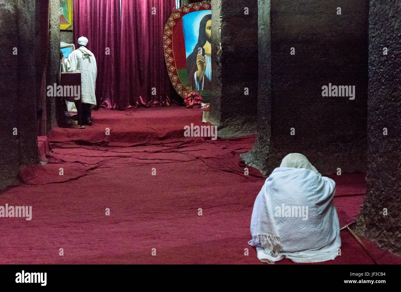 Lalibela, Ethiopia, A faithful and a priest in the Bet Mariam Orthodox churhc - Stock Image