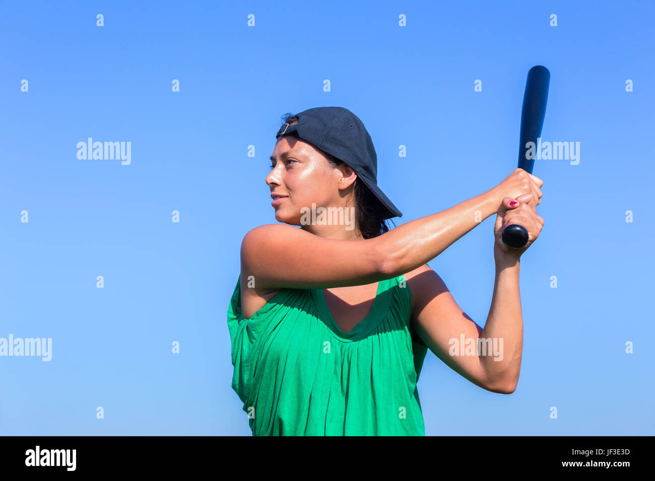 Young woman with baseball bat and cap - Stock Image
