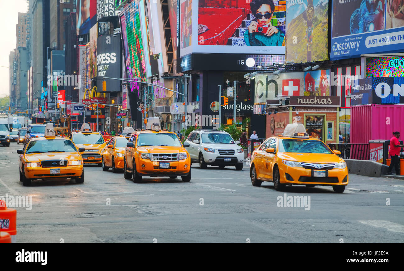 Yellow cabs at Times square in the morning - Stock Image