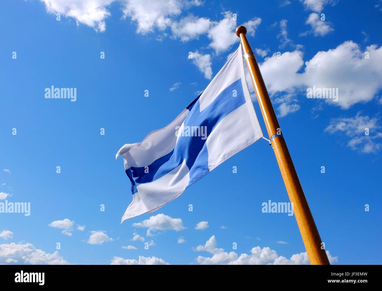 Flag of Finland on a wooden flagpole - Stock Image