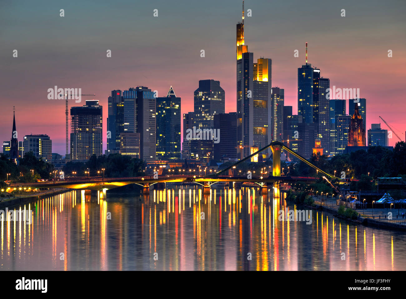 Frankfurt skyscrapers reflected on Main River at twilight, Germany - Stock Image