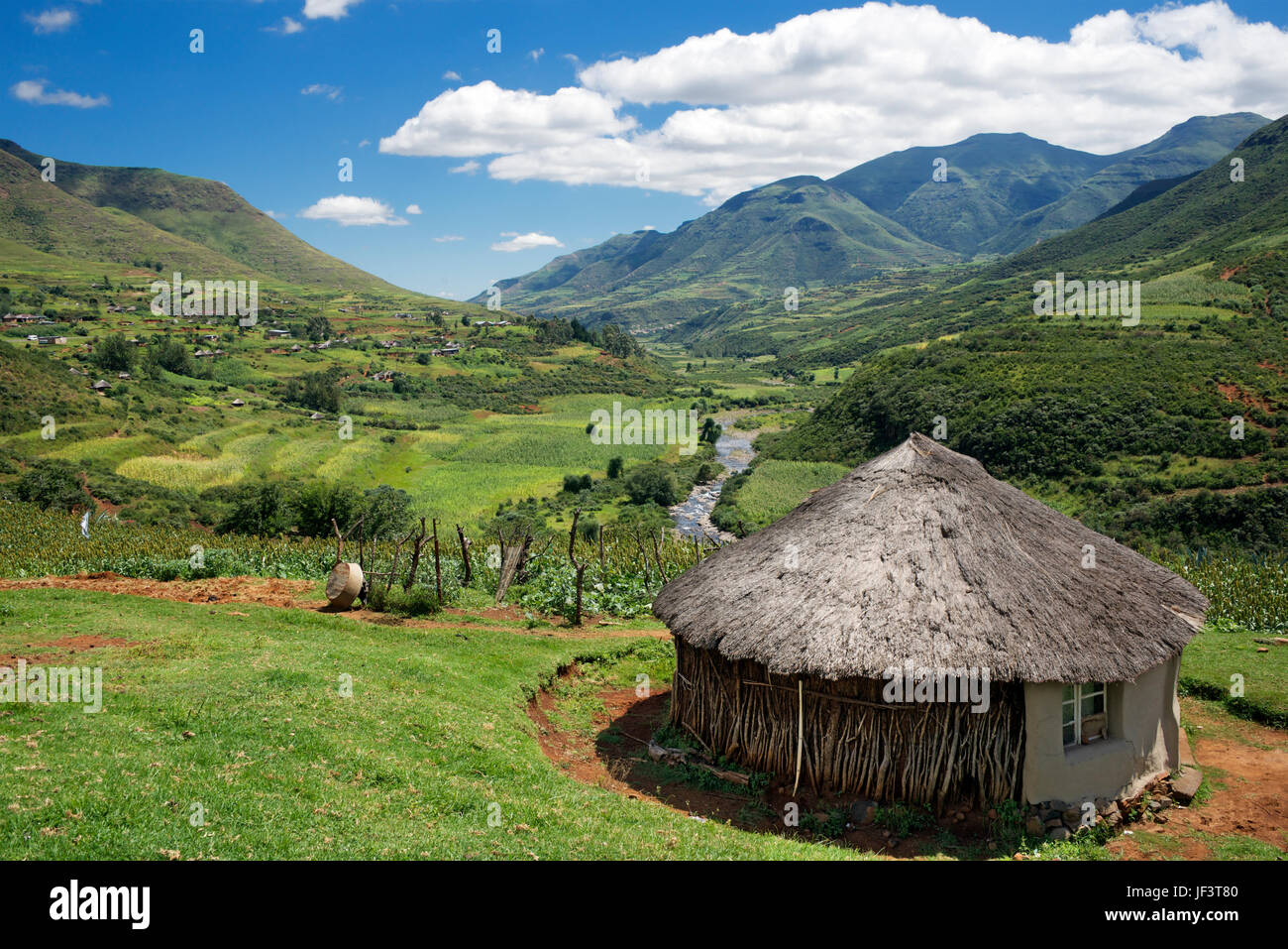 Landscape hlotse river valley with thatched rondavel house leribe district lesotho southern africa stock image