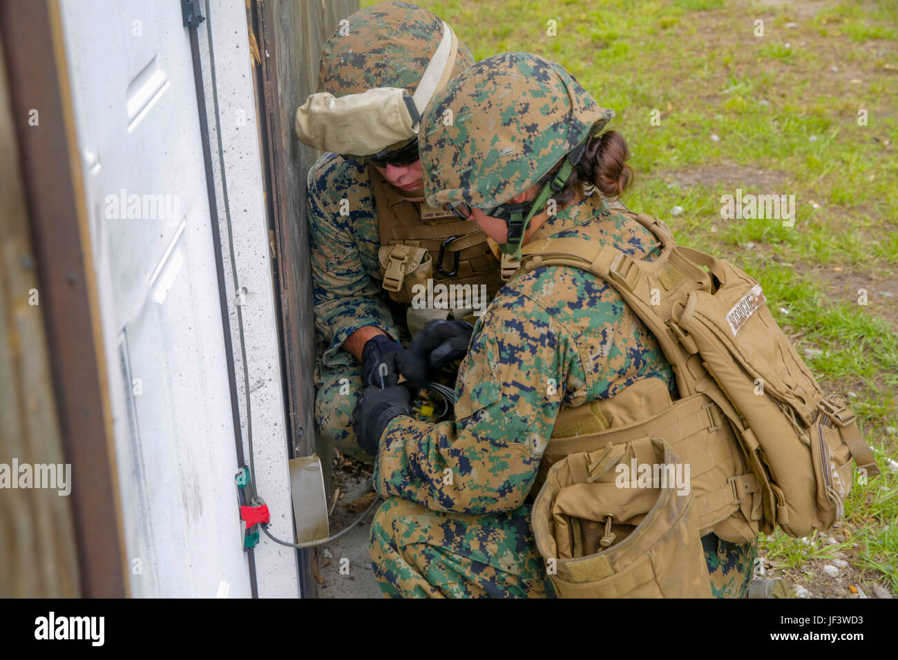 Marines prepare an Uli knot charge on a door as a part of urban breaching training at C& Lejeune N.C. May 24 2017. The Marines employed demolitions in ... & Marines prepare an Uli knot charge on a door as a part of urban ...