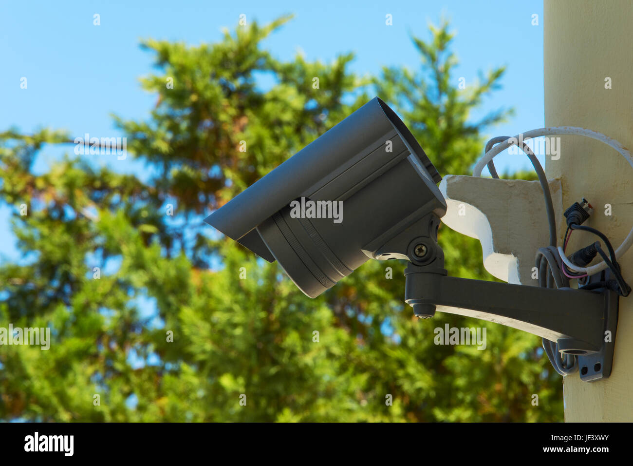 CCTV camera mounted on a building wall Stock Photo