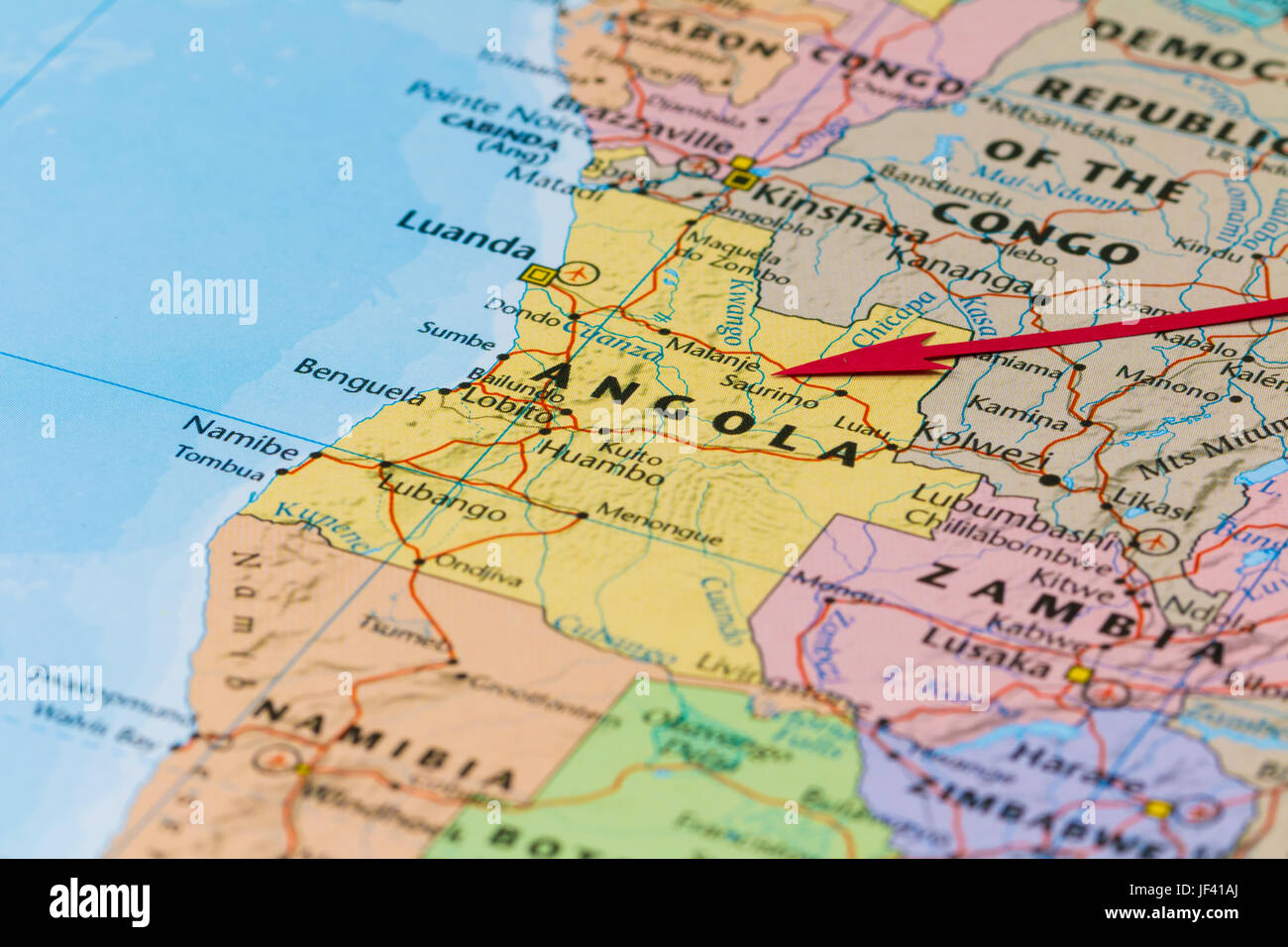 Photo of Angola. Country indicated by red arrow. Country on African continent. - Stock Image