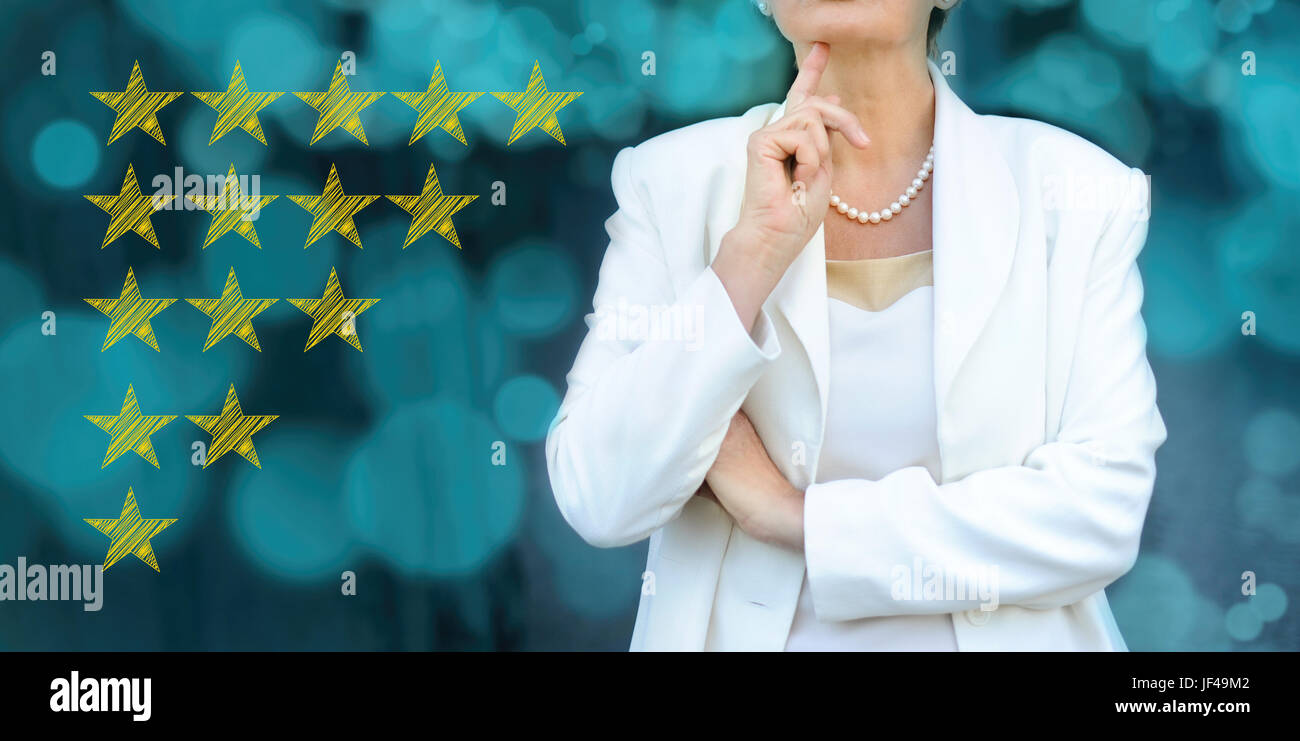Quality, performance review, evaluation and classification ranking concept. Senior businesswoman silhouette in bacground. - Stock Image