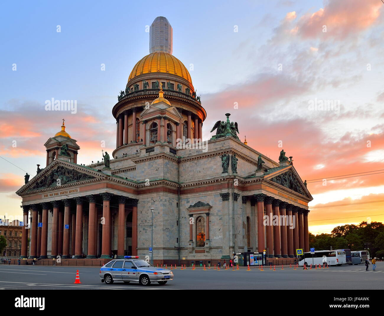 St PETERSBURG, RUSSIA - 19 JUNE 2017: St. Isaac's Cathedral at sunset under the clouds on the background of a police Stock Photo