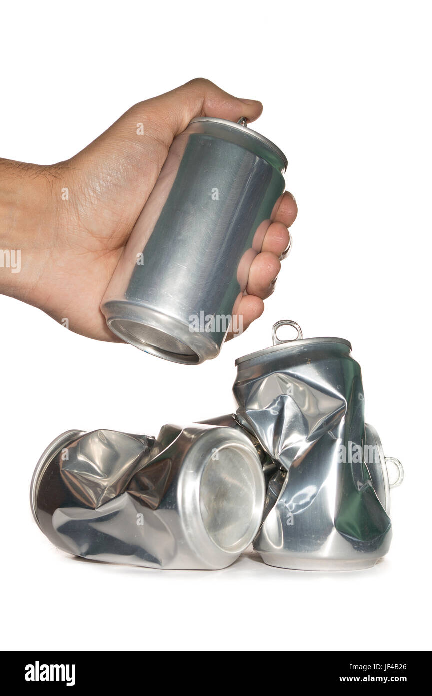 hand with dented cans on white background - Stock Image