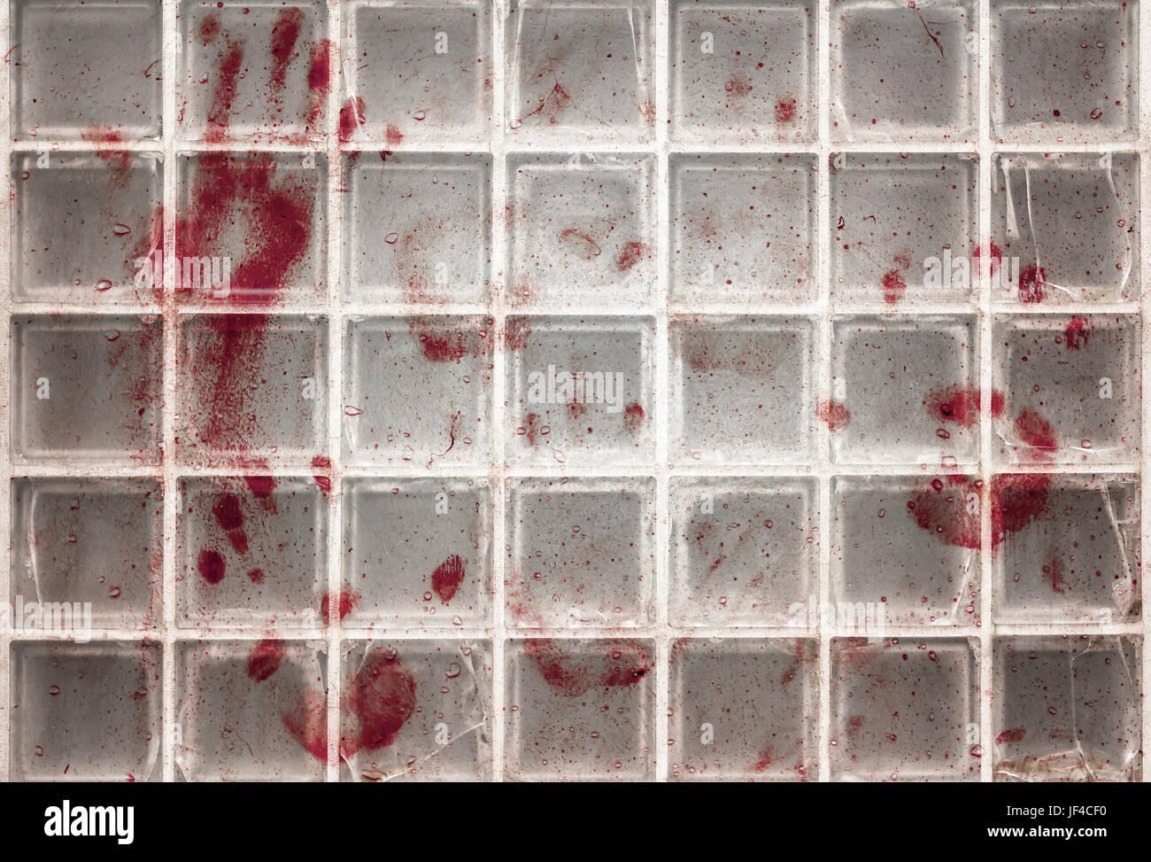 Bloody fingerprints on the glass - Stock Image