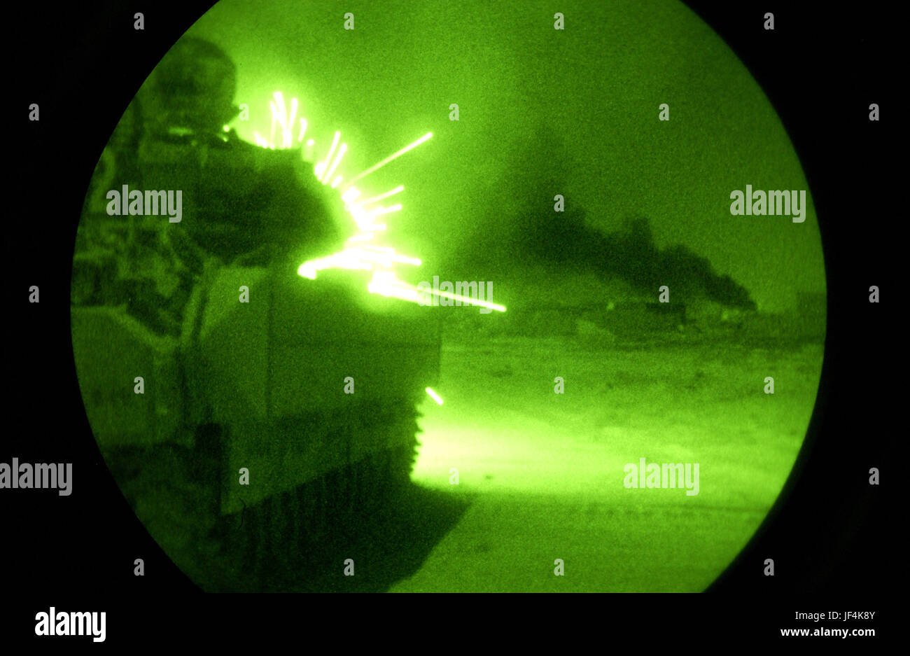 040930-F-2034C-012 An Army Bradley Fighting Vehicle opens fire with its 25-millimeter machine gun on anti-coalition Stock Photo
