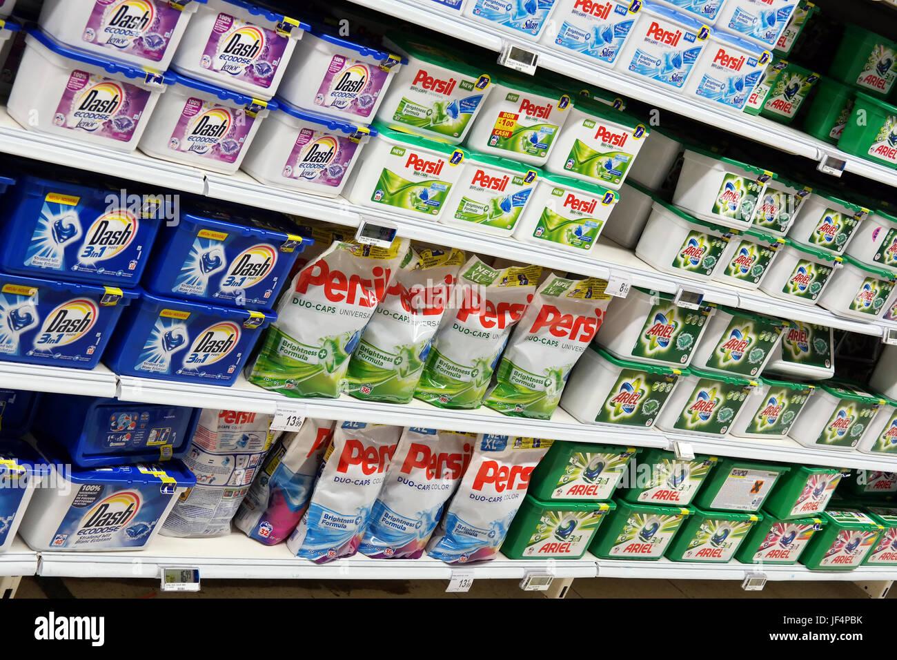 Dash, Persil and Ariel washing powder on a supermarket shelf - Stock Image