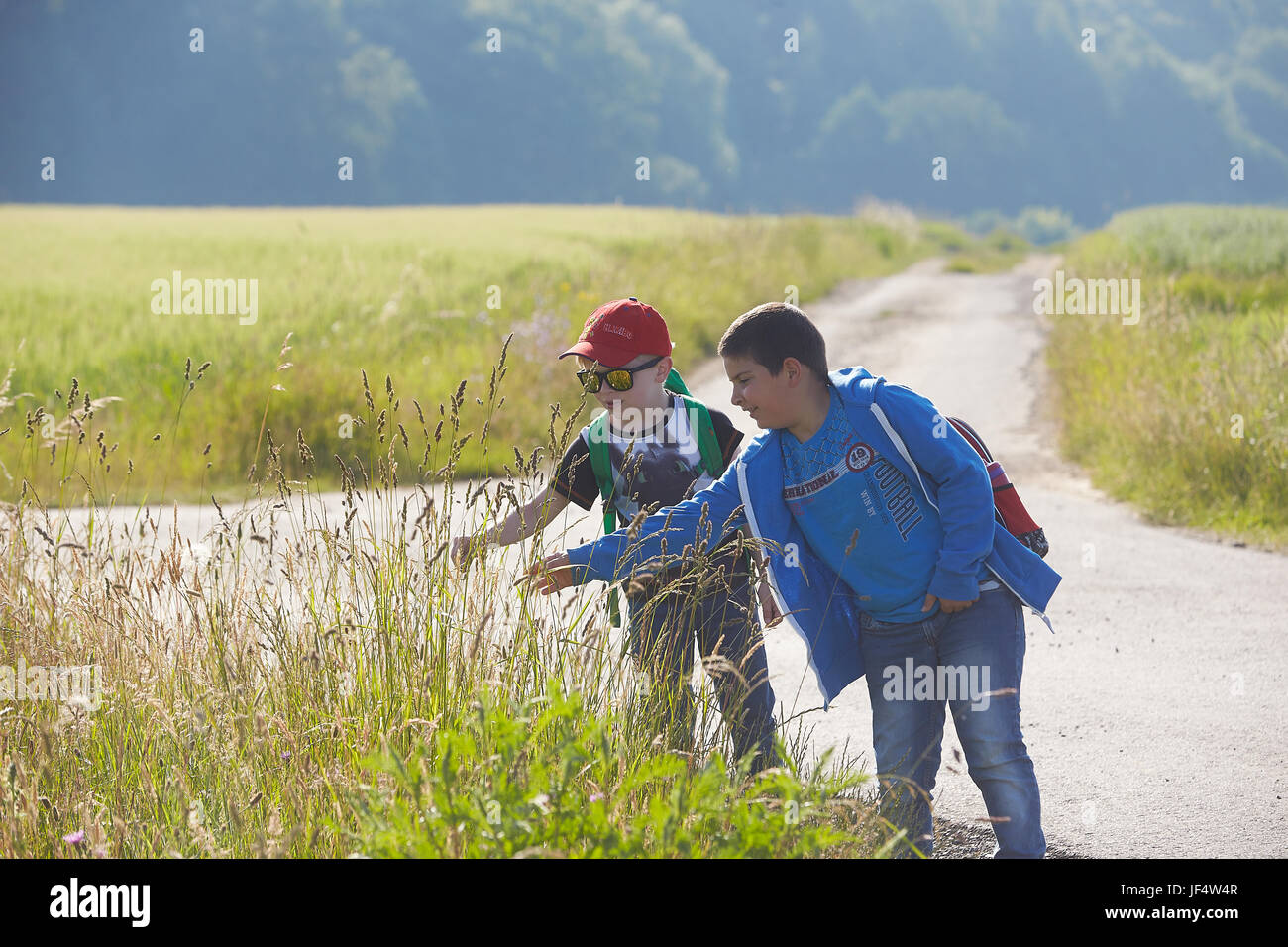 Niederahr, Germany. 14th June, 2017. Noah (L) and Kerem from Ahrbach primary school in the countryside in Niederahr, - Stock Image