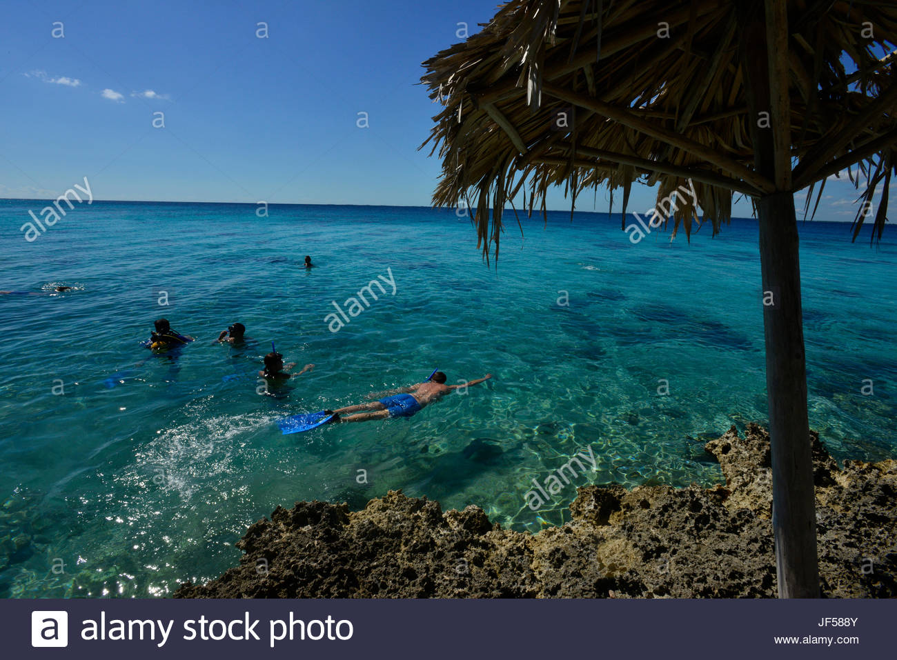 Swimmers in the Bay of Pigs. - Stock Image