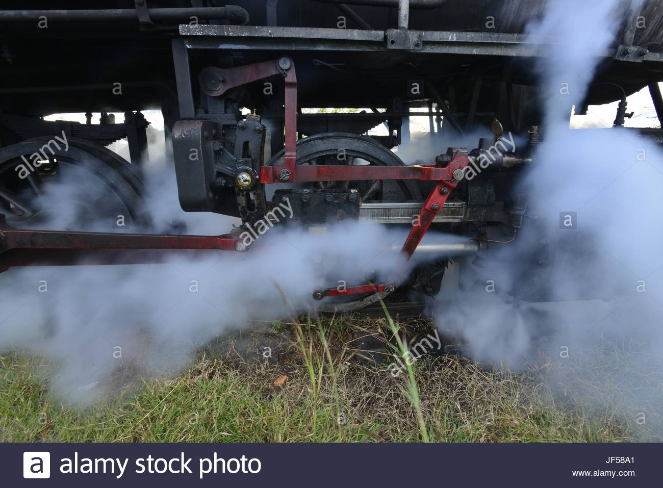 Steam escapes from a 1913 locomotive that was used in the transport of sugarcane. - Stock Image