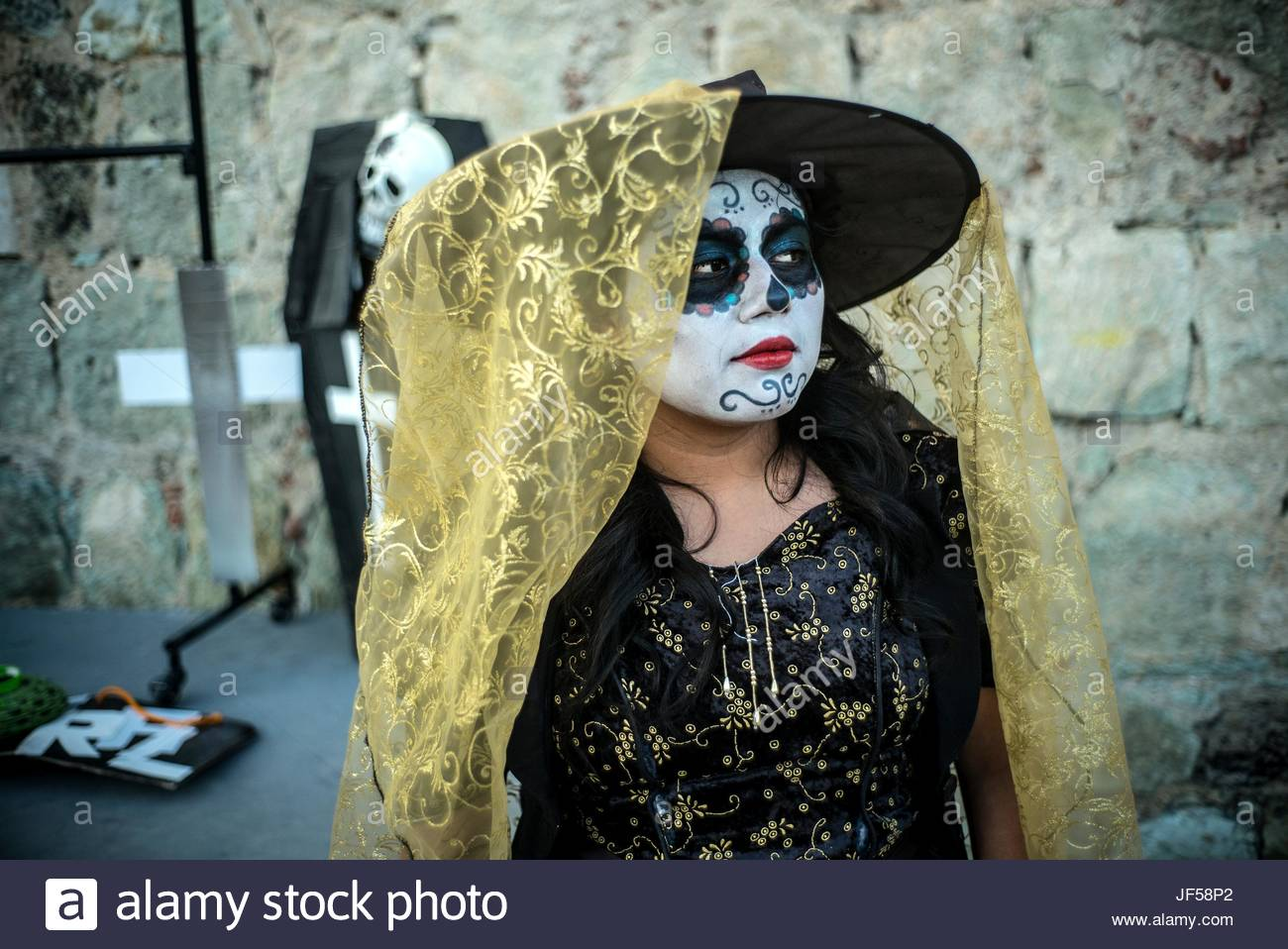 A participant dressed as La Catrina during the Day of the Dead celebrations. - Stock Image