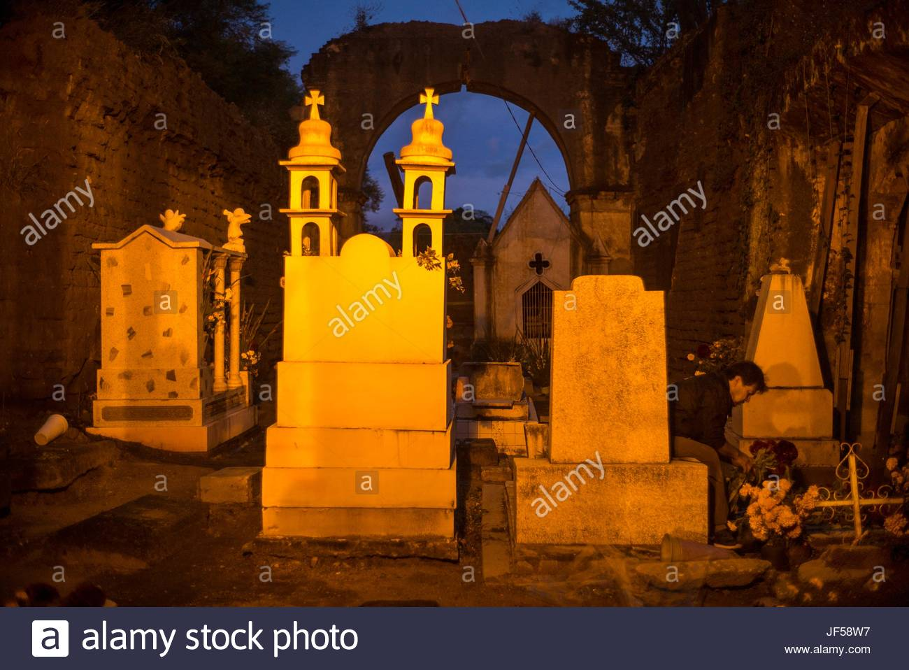 Tombs in a cemetery during the Day of the Dead celebrations. - Stock Image