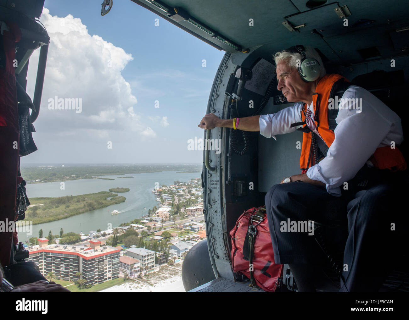 Congressman Charlie Crist, U.S. Representative for Florida's 13th District, keeps a eye on the coastline during - Stock Image
