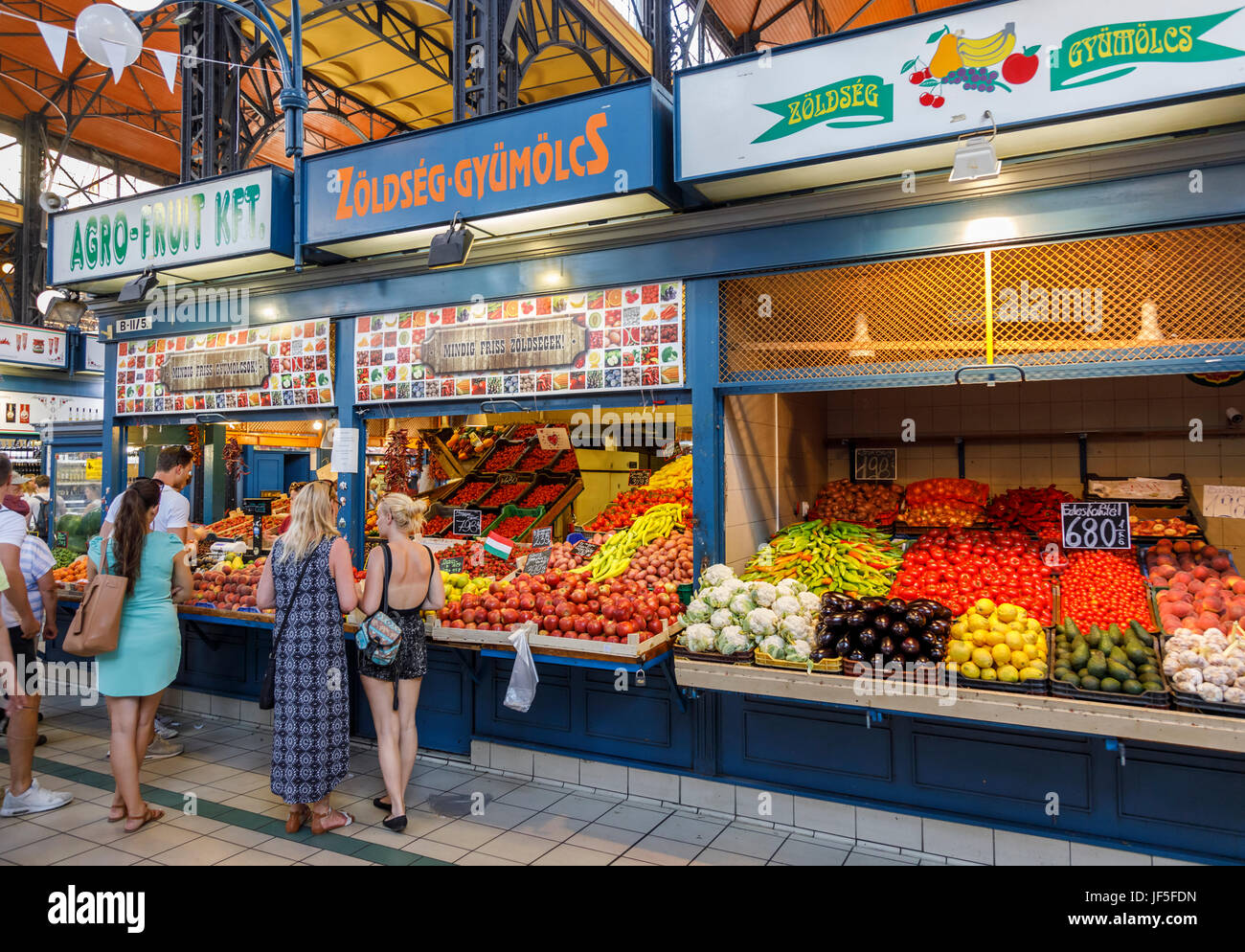 Colourful fruit and vegetable stalls with attractive displays in the covered Central Market Hall (Vasarcsarnok), Stock Photo