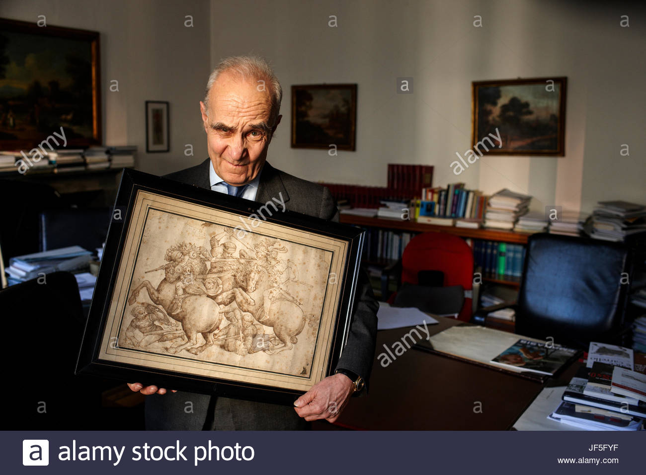 Milan lawyer Cosimo Rucellai with a copy of the Battle of Anghiari that is believed to have been copied from the - Stock Image