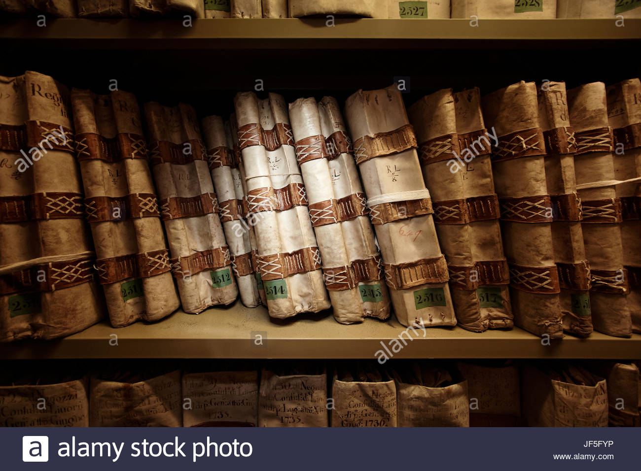A row of historical documents in the state archives in Florence, Italy. - Stock Image