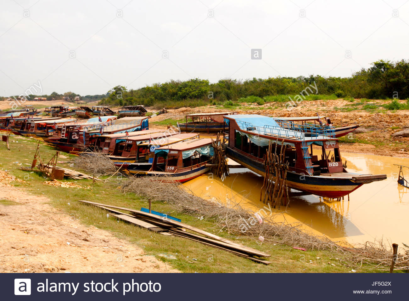 Boats on Tonle Sap during the dry season. - Stock Image