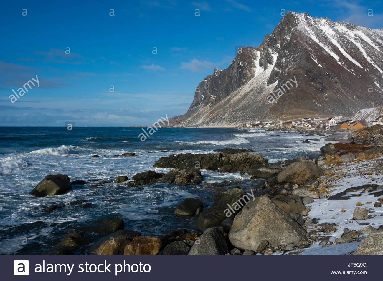 A view of the village of Vikten and rocky coastline. - Stock Image
