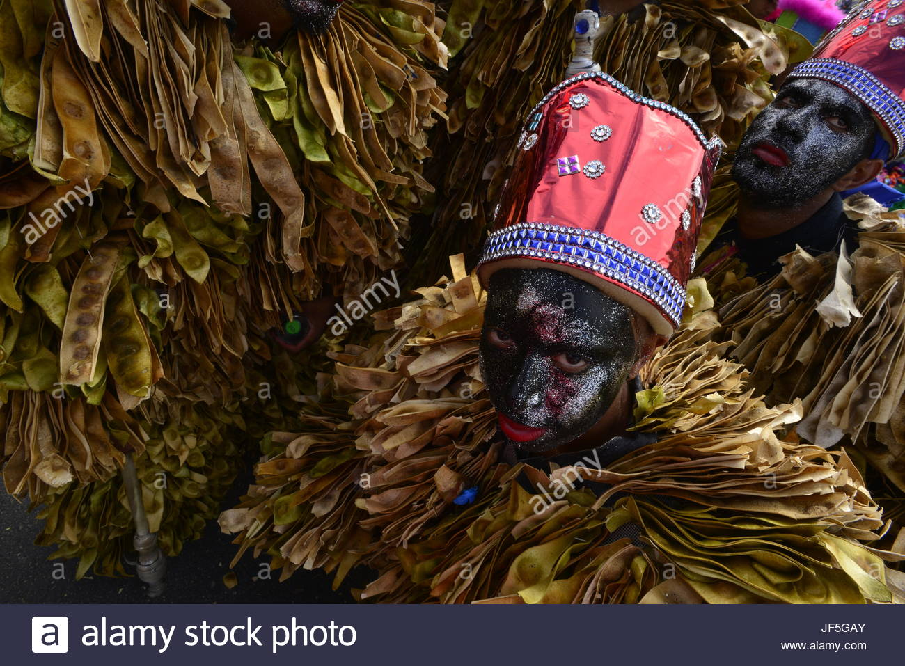 Men in costumes and face paint during Carnival. - Stock Image
