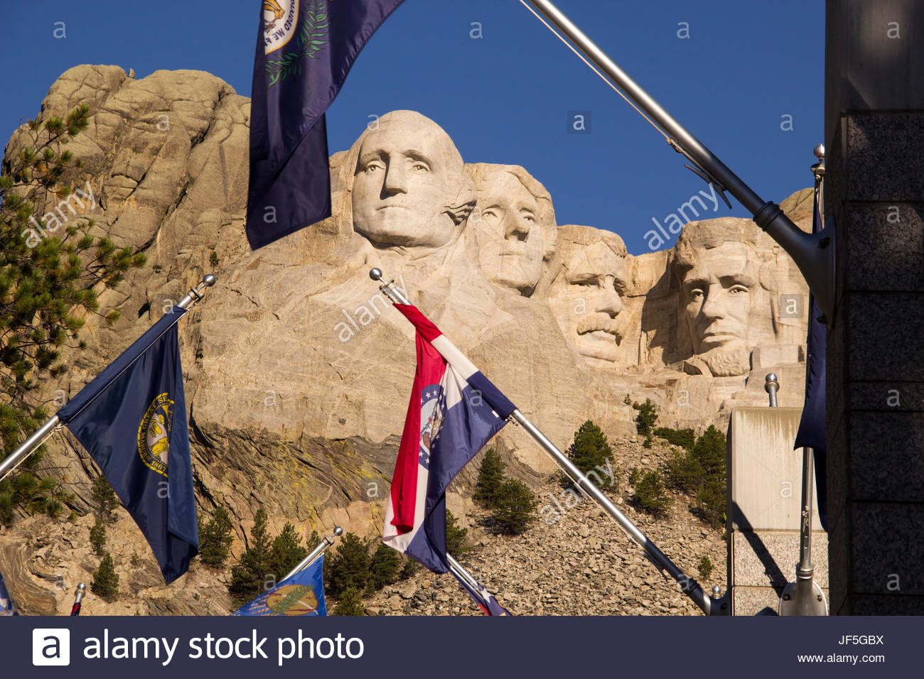State flags frame the landmark sculpture of United States presidents. - Stock Image