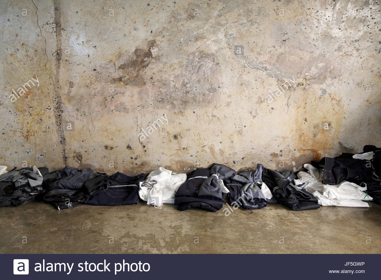 Jeans on display in a showroom at a denim factory. - Stock Image