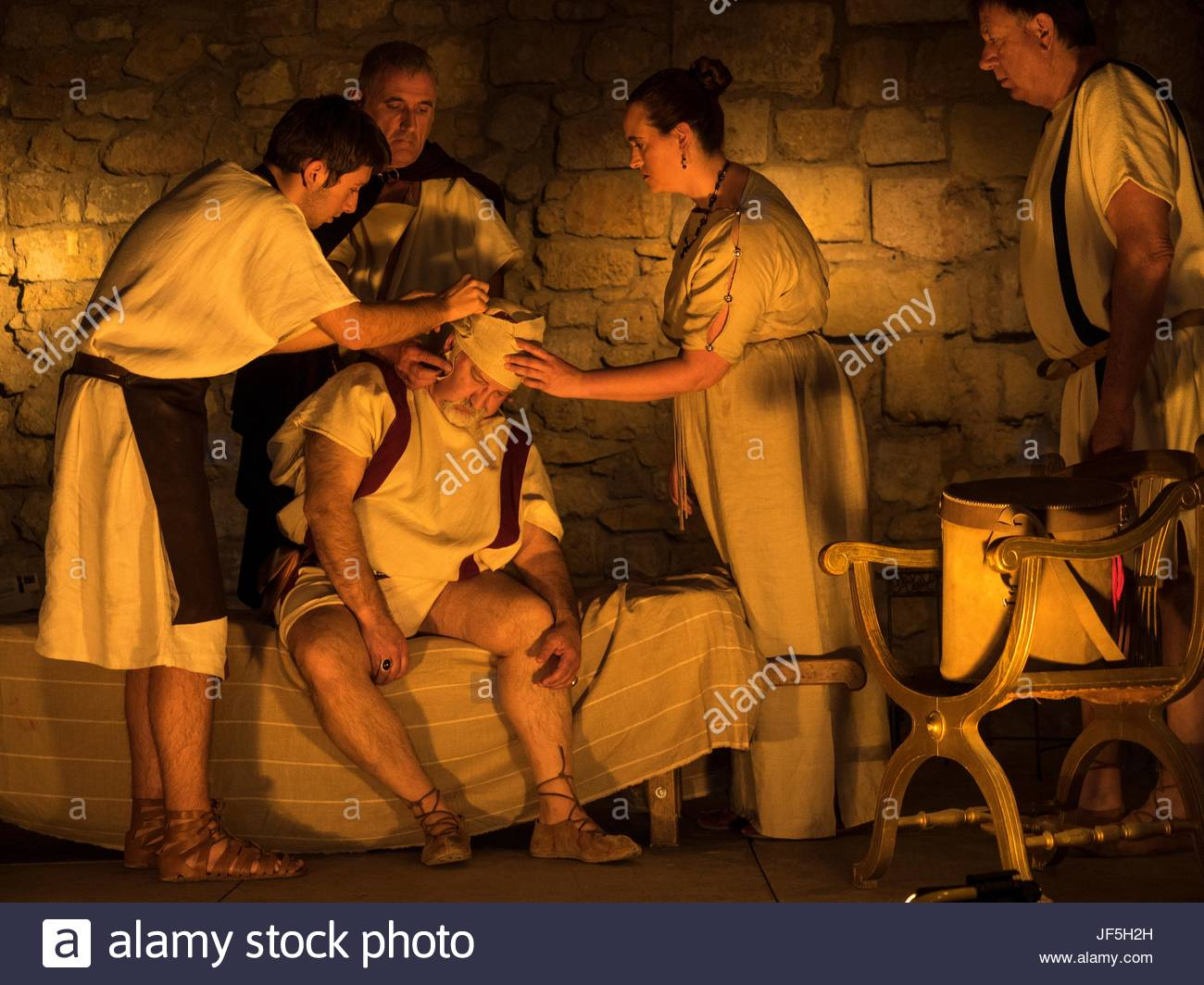 A historical reenactment of healing in Roman times. - Stock Image