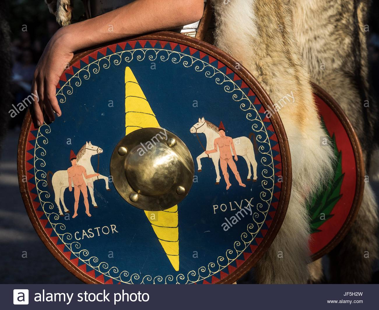 The shield of a participant, dressed in Roman costume during a historical reenactment, - Stock Image
