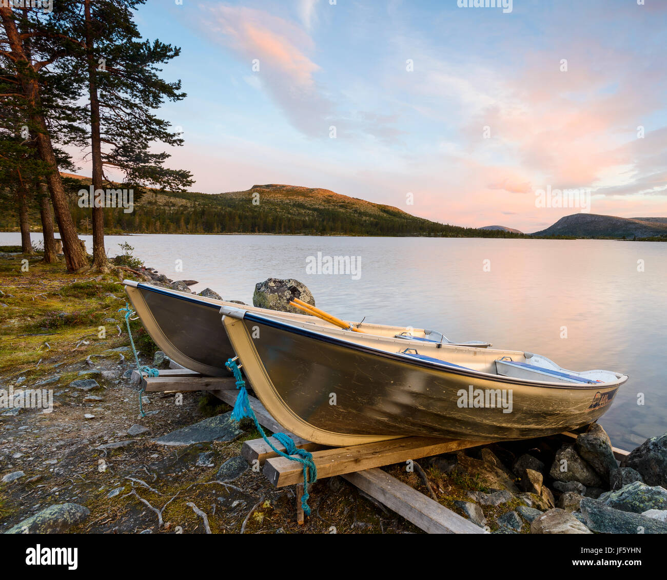 Rowing boats on coast - Stock Image