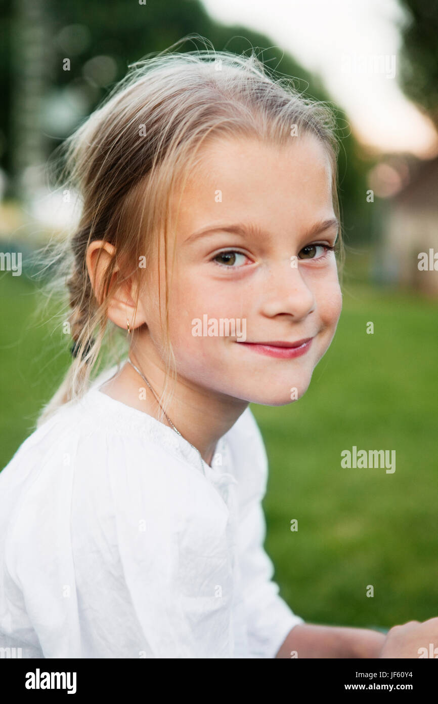 Portrait of smiling girl - Stock Image