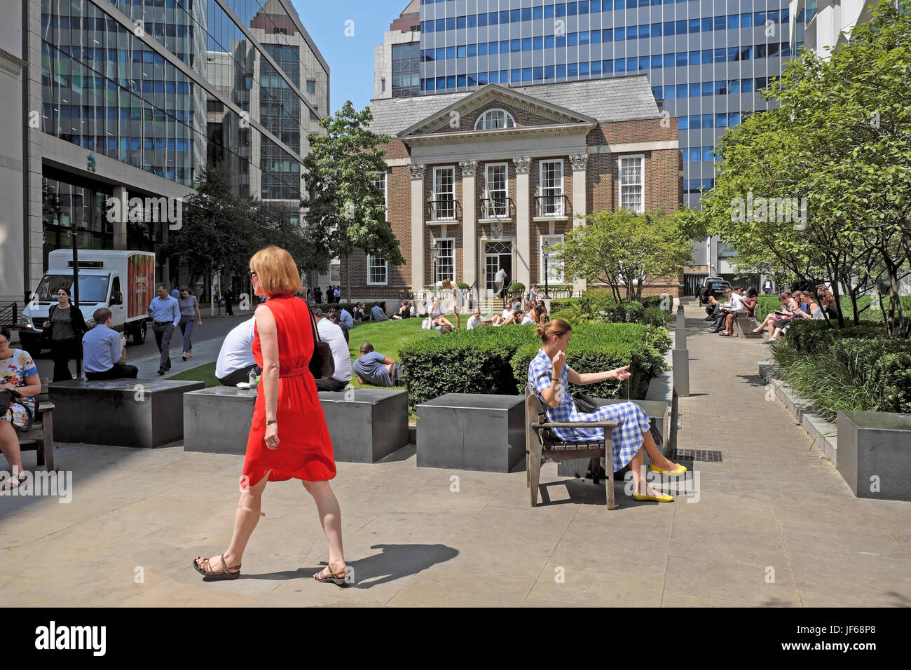 Office workers sitting outside in Girdlers Gardens in summer at lunchtime Basinghall Street Moorgate in the City - Stock Image