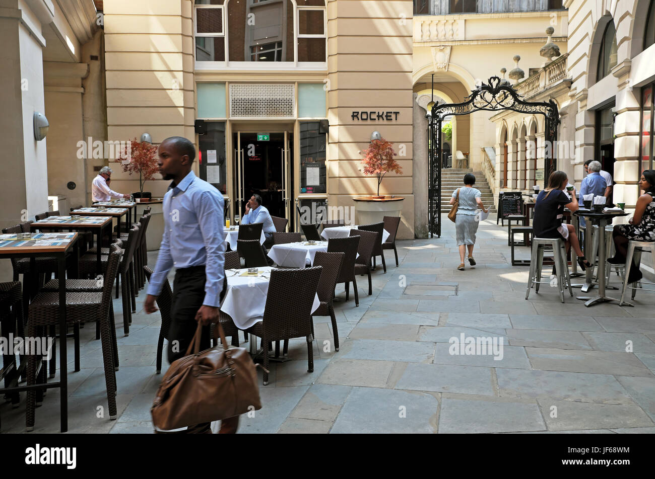 Outdoor dining area in Adam's Court of Rocket Restaurant Old Broad Street in the City of London Square Mile - Stock Image