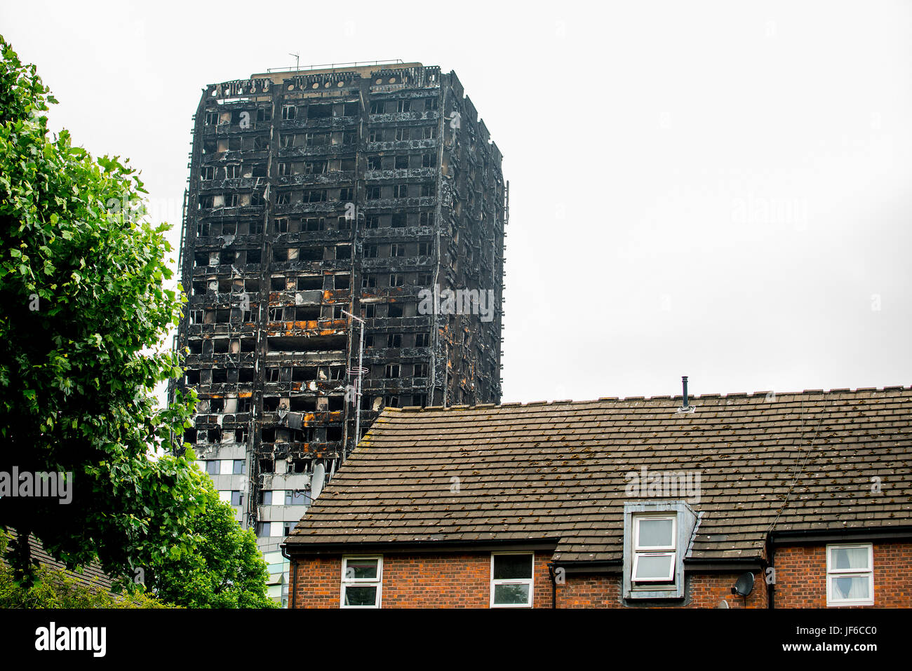The burnt remains & devastation caused by fire, which ripped through the Grenfell Tower block leaving hundreds - Stock Image