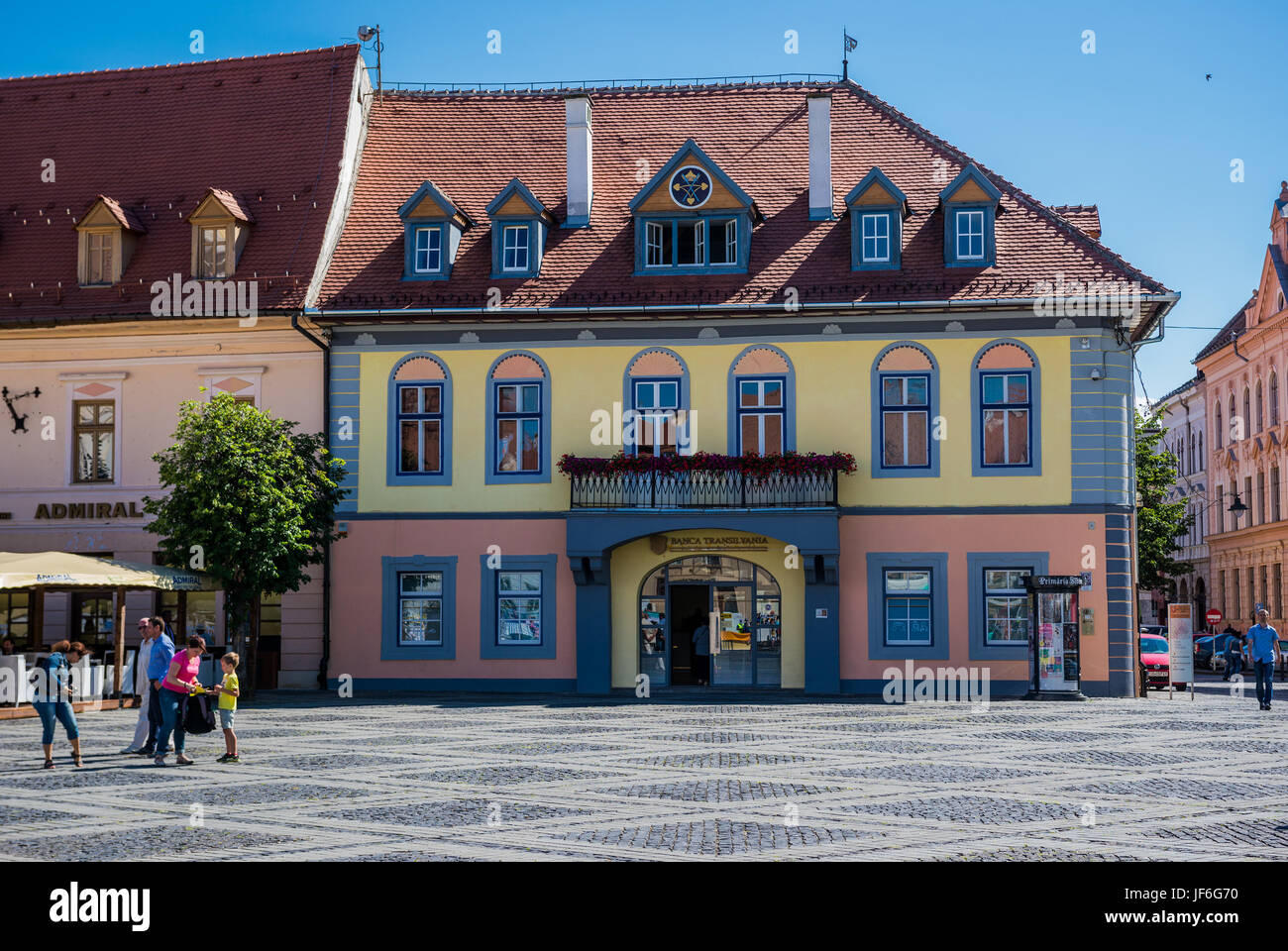 Lutsch House (Casa Lutsch) with Banca Transilvania bank on Large Square in Historic Center of Sibiu city of Transylvania - Stock Image