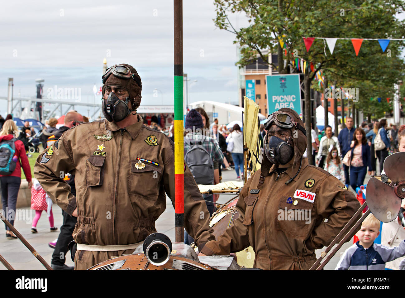Liverpool, UK. 25th June, 2017. Street entertainers dressed up in RAF googles and helmets at the Mersey River Festival - Stock Image