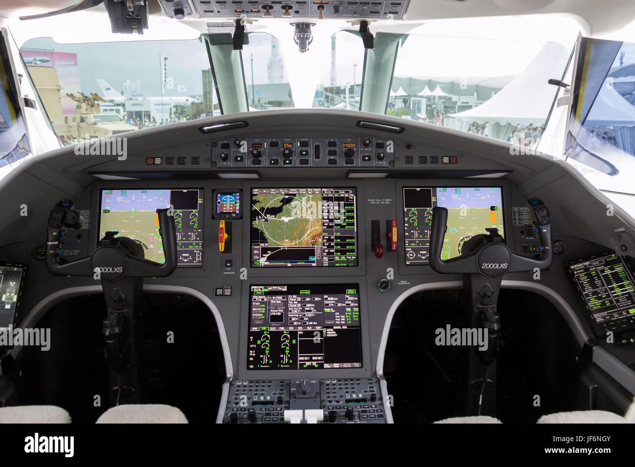 PARIS, FRANCE - JUN 23, 2017: Modern glass cockpit of the Dassault Falcon 2000LX business jet at the Paris Air Show - Stock Image