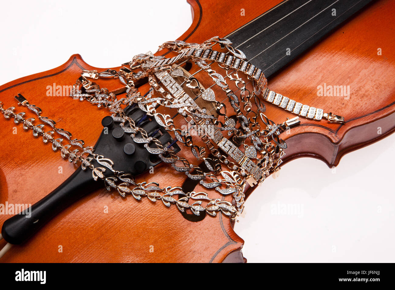 Golden Bracelets And Violin - Stock Image